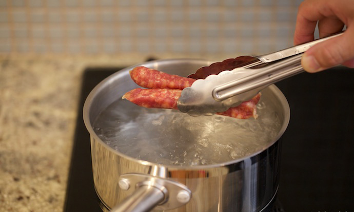 Put sausage into the boiling water