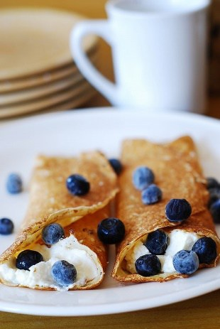 stuffed crepes with ricotta cheese and blueberry filling
