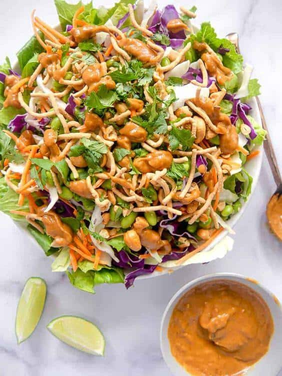 Asian salad with spicy peanut dressing